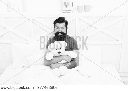 Cute And Romantic. Bearded Hipster Play Toy. Valentines Day Gift. Man Hug Soft Toy Relaxing In Bed.