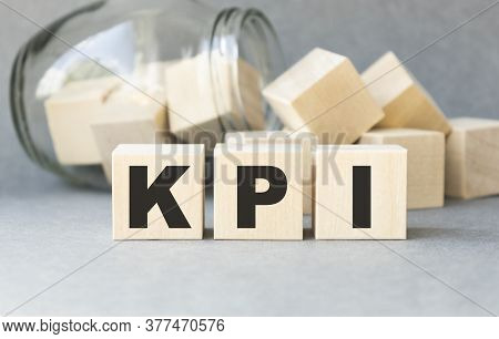 Kpi - Wooden Blocks With Letters, Key Performance Indicator Kpi Concept, Top View On White Backgroun