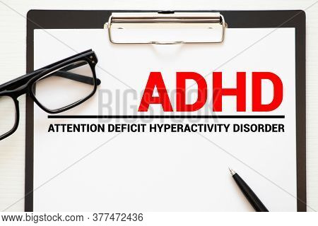 Notebook Page With Text Adhd - Attention Deficit Hyperactivity Disorder, On A Table With A Stethosco