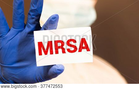Doctors Hands In Blue Gloves Shows The Word Mrsa Methicillin-resistant Staphylococcus Aureus. Medica