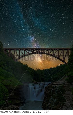 Milky Way Over The Genesee Arch Bridge And Upper Falls At Letchworth State Park In New York