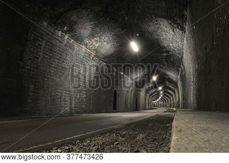 Monsal Trail Road Passes Through Headstone Tunnel, Made Of Dark Grey Bricks, A Low And Wide Angle Im