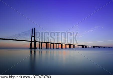 Sunrise At Vasco Da Gama Bridge, The Longest Bridge In Europe, Who Spans The Tagus River, In Lisbon,