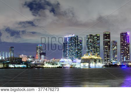 Miami Skyline. Cruise Ship In The Port Of Miami At Sunset With Multiple Luxury Yachts. Beautiful Mia