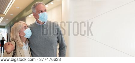 Mature couple shopping together during coronavirus pandemic