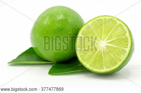 Lime With Half And Leaves Isolated On White Background.