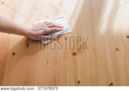 Hand Cleaning Woooden Coffee Table With Disinfectant Wet Wipe Concept Of The New Normal After Covid-
