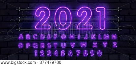 Purple Vector Neon Tube Alphabet Font. Neon Color Letters, Numbers And Symbols. Stock Vector Typefac