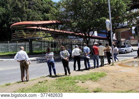 Salvador, Bahia / Brazil - August 22, 2013: Pedestrians Crossing A Car Track Under A Pedestrian Walk