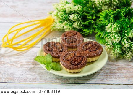 Chocolate Tart Brownies With Raisins On Green Dish - Stock Photo