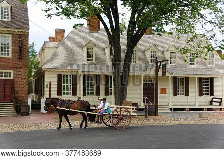 Williamsburg, Virginia, U.s.a - June 30, 2020 - Two Man On The Horse Carriage Wearing A Mask As Requ