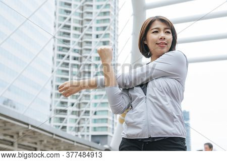 Sport Fitness Women Running Exercise In Modern City Wear Wellness Sportswear Outside. Young Woman Wo