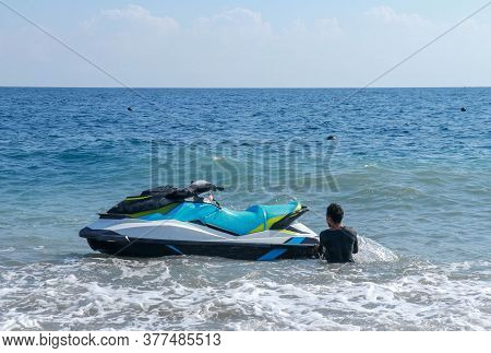 Jetski Floating On Blue Sea Water. Strong Power Watercraft Is Waiting Customers. Young Indonesian Ho