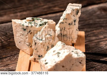 Tasty Blue Cheese On A Wooden Background. Dorblu Cheese Pieces, Danish Blue Cheese.