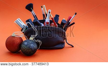 Make-up Tools And Xmas Decoration Against Red Background, Copy Space
