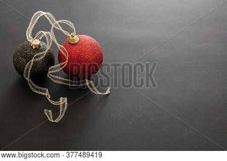 Christmas Red And Black Balls Against Black Background, Copy Space