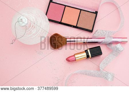 Christmas Party Make-up Cosmetics Against Pink Background