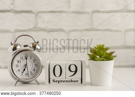 September 9 On A Wooden Calendar Next To The Alarm Clock.september Day, Empty Space For Text.calenda