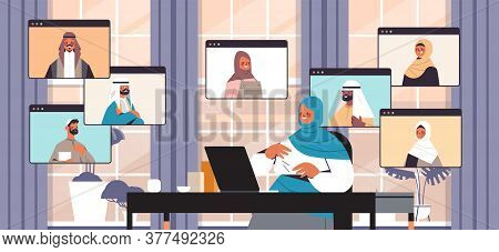 Arabic Businesswoman Chatting With Arabian Colleagues During Video Call Business People Having Onlin