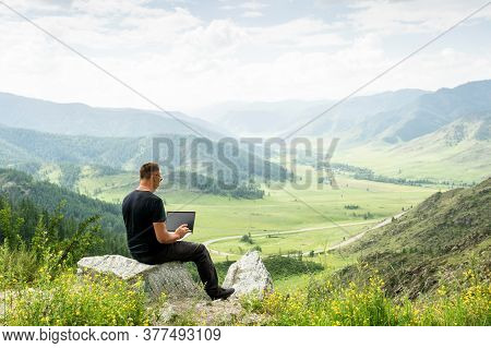 Traveler Blogger Work Remote On Netbook Computer While Enjoying Mountain Nature Landscape View Outdo