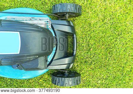 Mowing Lawns. Top View Lawn Mower On Green Grass. Mower Grass Equipment. Mowing Gardener Care Work T