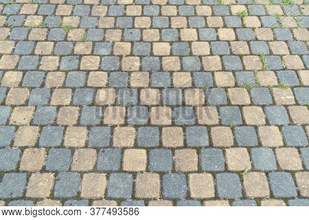 Sidewalk Tiles. Closeup Of Paving Slabs Background. Street Paving Slabs. Cement Block Of The Road. C