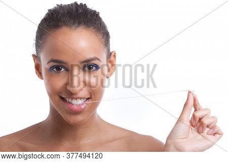 Portrait of beautiful young woman pulling chewing gum from her mouth against white background