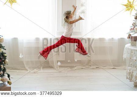 Cute Adorable Little Blond Caucasian Kid Girl Fun Make Dramatic Ballet Leap Contemporary Dance In Ro