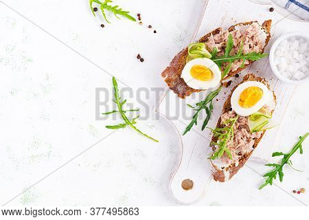 Toasts With Tuna. Italian Bruschetta Sandwiches With Canned Tuna, Egg And Cucumber. Top View, Flat L