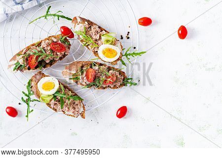 Toasts With Tuna. Italian Bruschetta Sandwiches With Canned Tuna, Tomatoes And Capers. Top View, Fla