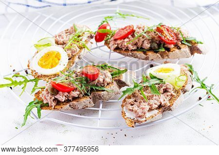 Toasts With Tuna. Italian Bruschetta Sandwiches With Canned Tuna, Tomatoes And Capers. Copy Space