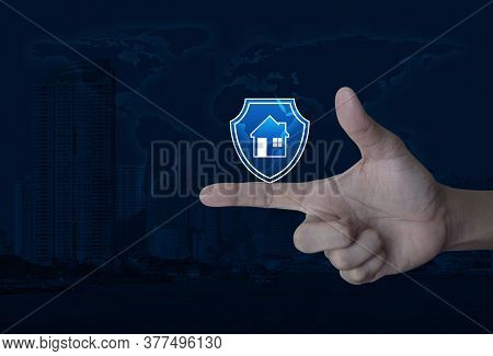 Hand Pressing House With Shield Flat Icon Over World Map, Modern City Tower And Skyscraper, Business