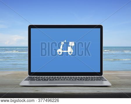Motorcycle Flat Icon With Modern Laptop Computer On Wooden Table Over Tropical Sea And Blue Sky With