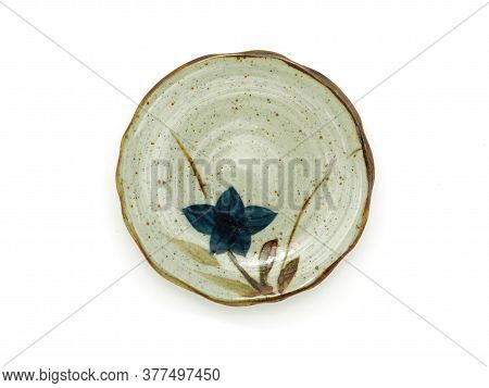 Empty Circle Ceramic Plate With A Brown Rim And Flower Pattern Isolated On A White Background. Japan