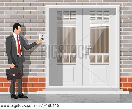 Businessman In Suit With Briefcase Push Bell Button At The Front Door. Finger Presses The Doorbell S