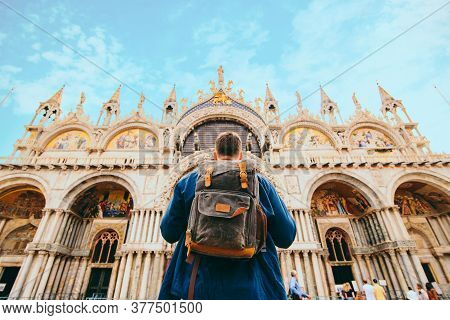 Tourist Man With Backpack Standing In Front Of Saint Marco Basilica Venice, Italy