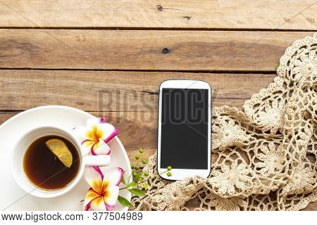 Mobile Phone ,hot Coffee Lemon ,knitting And Flowers Frangipani Of Lifestyle Woman Relax Arrangement