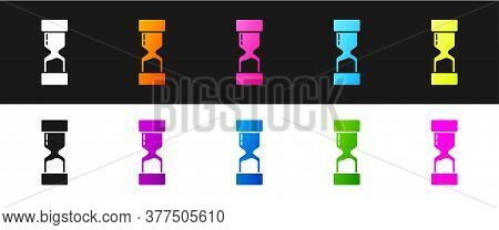 Set Old Hourglass With Flowing Sand Icon Isolated On Black And White Background. Sand Clock Sign. Bu