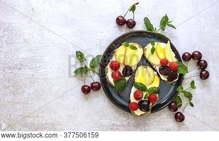 Delicious French Toast With Fresh Fruits, Berries, And Honey. Tasty Breakfast Scene Or Dessert With