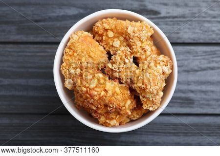 Bucket With Yummy Nuggets On Dark Wooden Table, Top View