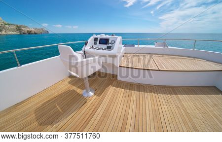 Ocean calm water view from yacht flybridge open deck, modern and luxury equipped with navigation dashboard devices. Lifestyle freedom concept.