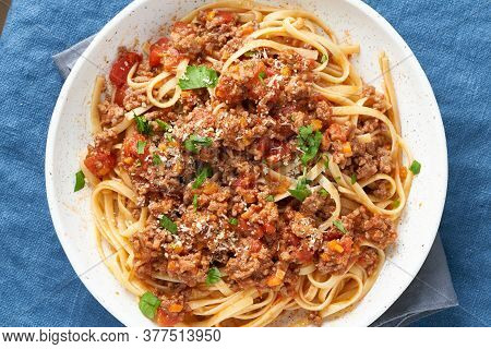 Pasta Bolognese Linguine With Mincemeat And Tomato Sauce. Top View, Close Up