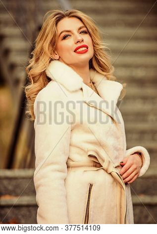 Businesswoman. Faux Fur Coat Fashion. Stylish Business Lady Leather Bag. Glamour Girl Look Luxurious
