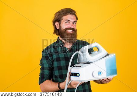 Happy Man With Iron. Perfect Husband Duty. Bearded Male Housekeeper. Hipster Ironing Clothes. New Te