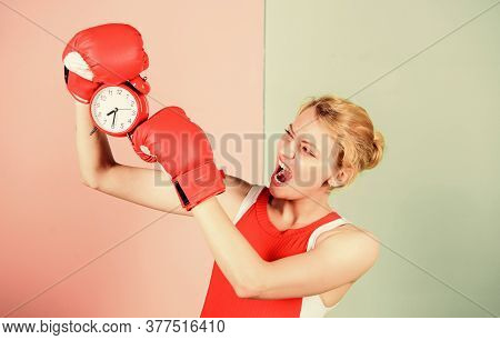Establishing The Clock Time. Cute Boxer With Angry Look Fighting With Alarm Clock. Emotional Woman H
