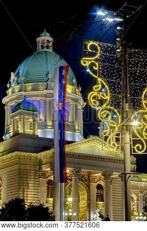 Night View Of The National Assembly Of The Republic Of Serbia With New Year Street Lights Decoration