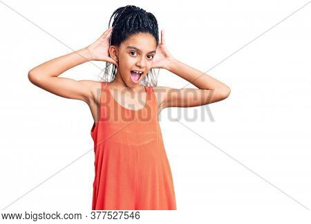Cute african american girl wearing casual clothes smiling cheerful playing peek a boo with hands showing face. surprised and exited