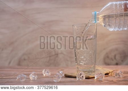 Drinking Water On Wooden Table Background And Space For Text