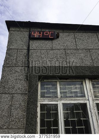 Concept On The Topic Of Abnormal Hot Summer. Digital Display Thermometer Which Shows 44 Degrees Cels