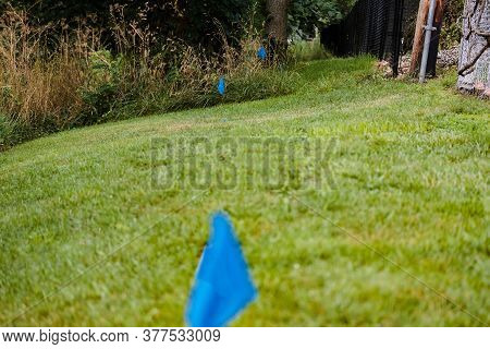 Blue Surveyors Flag And Stake Marks The Location Of A Water Pipe